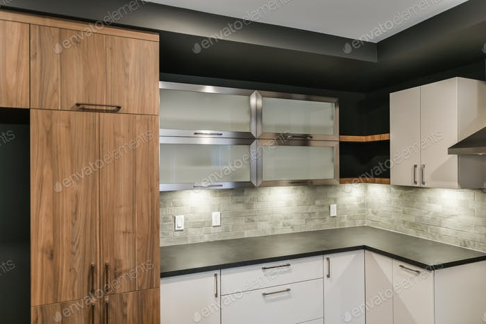 Contemporary kitchen cabinet ensemble with different colors and textures
