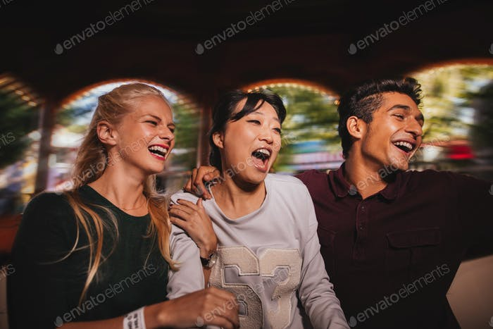 Young man and women having fun together on amusement park