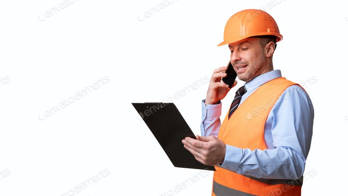 Builder In Uniform Talking On Phone Standing On White Background