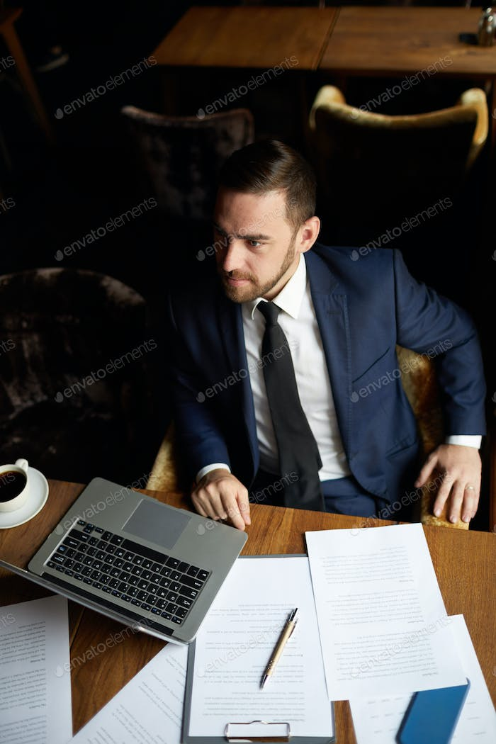 Content businessman making order in restaurant