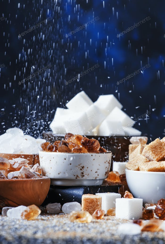 Assorted different types of sugar in bowls
