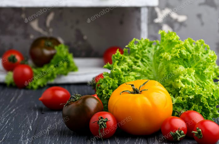 Colorful tomatoes on black background