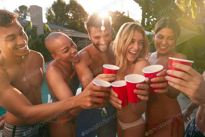 Group Of Smiling Friends Outdoors Making A Toast With Beer And Enjoying Summer Pool Party
