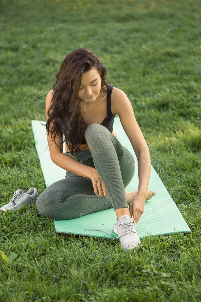 Woman tying shoes. Healthy lifestyle concept. Happy Sport Life