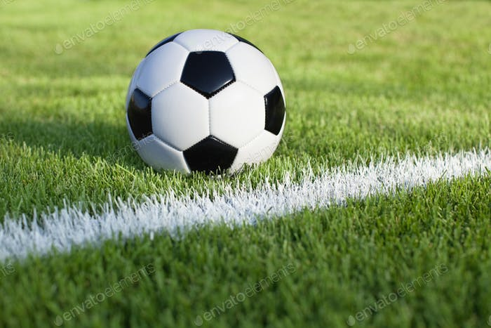 Soccer Ball on Grass Field with Stripe