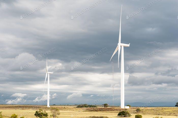 Wind turbines against dark clouds