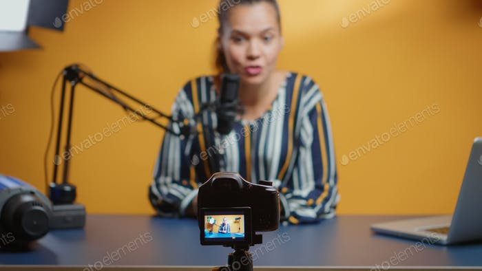 Selective focus on camera while social media star records an new podcast episode