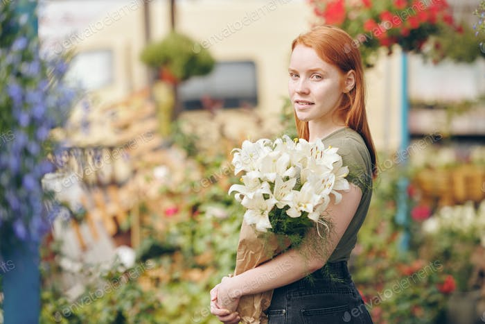 Attractive girl working with flowers