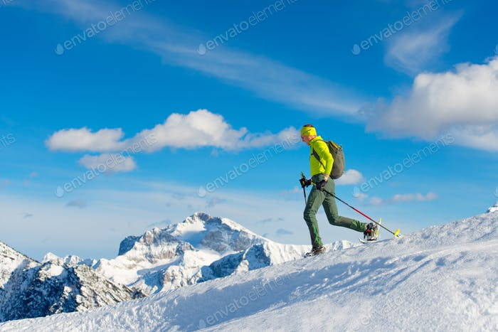 Man with snowshoes