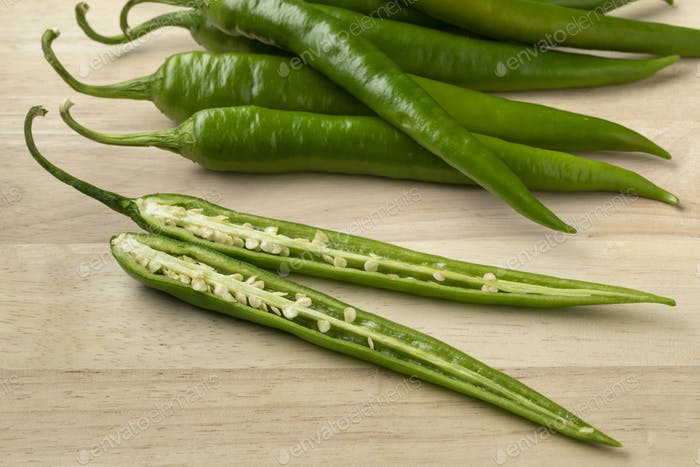 Fresh green sliced chili pepper close up