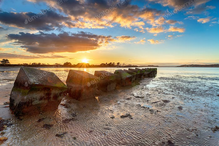 Beautiful sunset over old WWII tank traps in Bramble Bush Bay