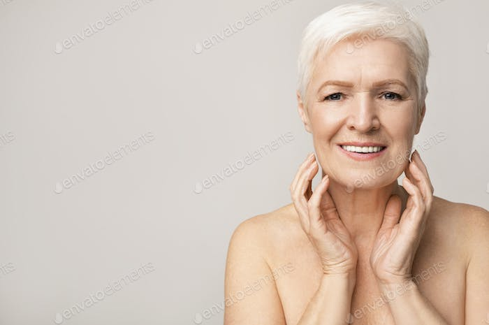Portrait of attractive senior woman touching her chin
