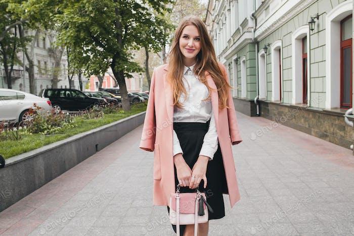 young stylish beautiful woman walking in street