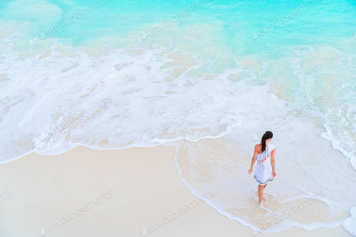 Woman at beach having a lot of fun in shallow water