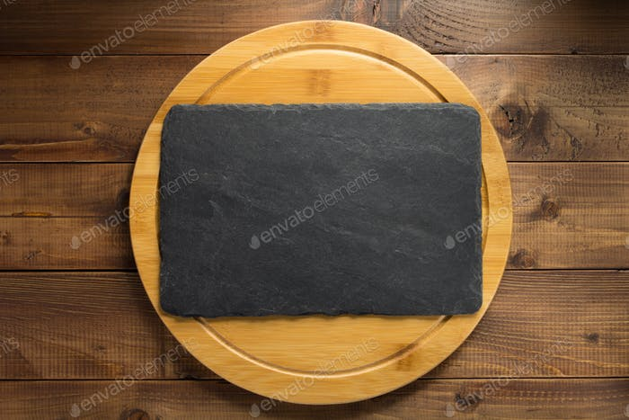 slate stone at wooden cutting board