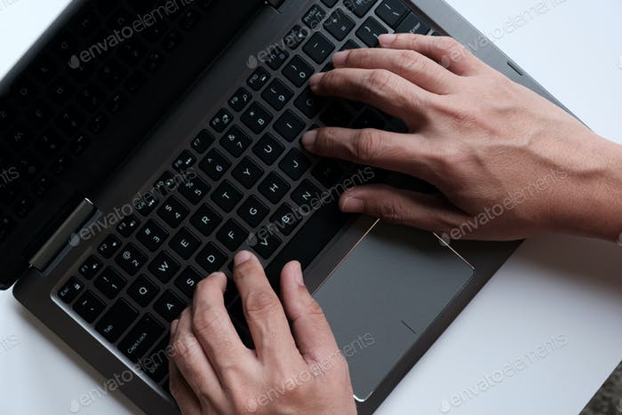 Hands with laptop typing