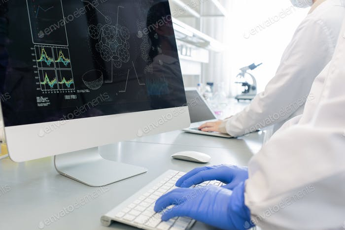 Unrecognizable Scientists Working On Computers