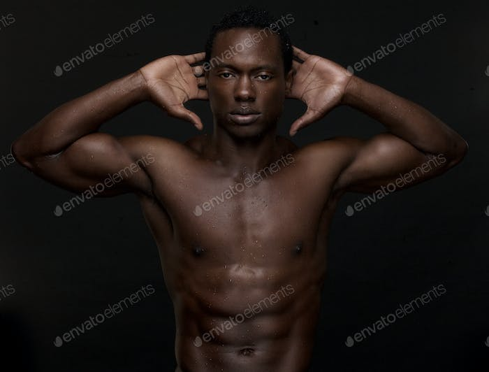 Sexy African American Man with Hands to Head