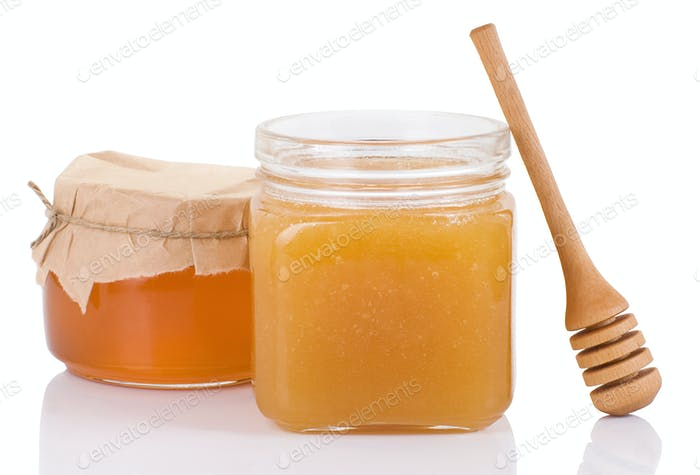 pot full of honey and stick isolated on white