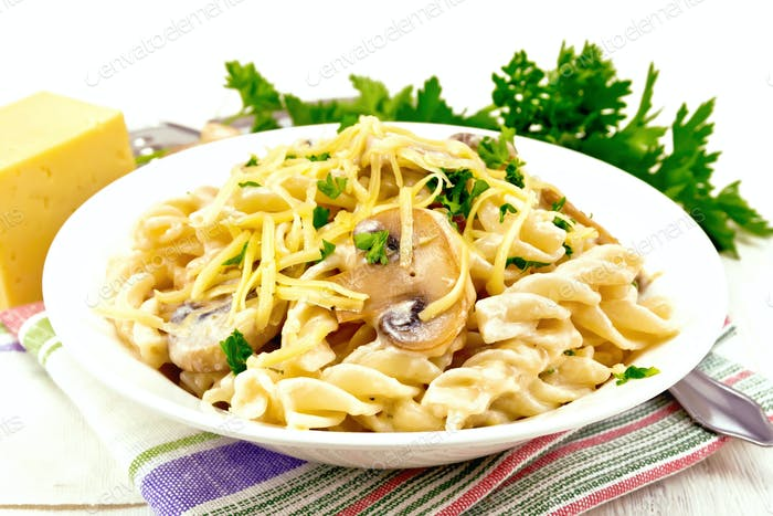 Fusilli with mushrooms on napkin