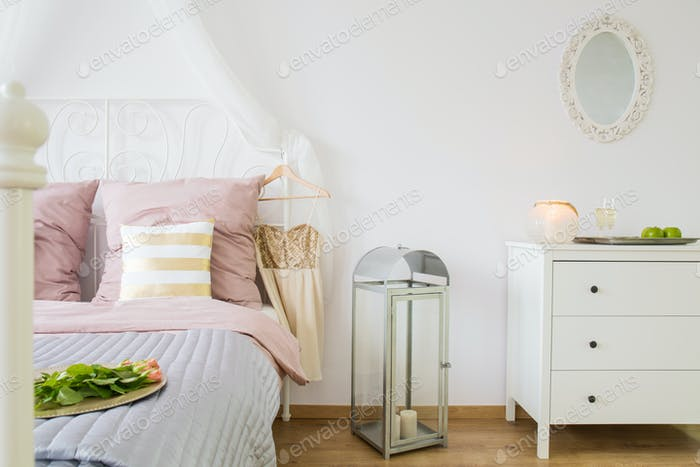 Bed, dresser and decorative lantern