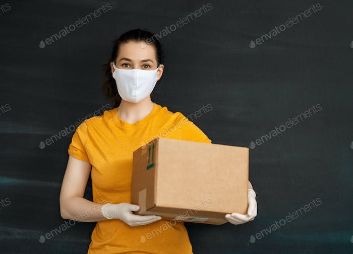 Delivery woman holding cardboard box