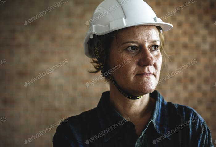 Woman constructor wearing hard helmet
