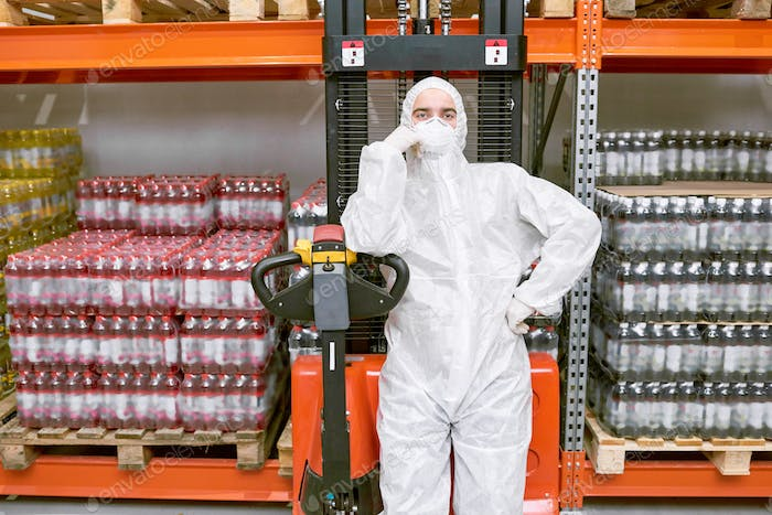 Storage worker standing in protective clothing