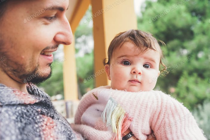 Dad hugging her little baby girl