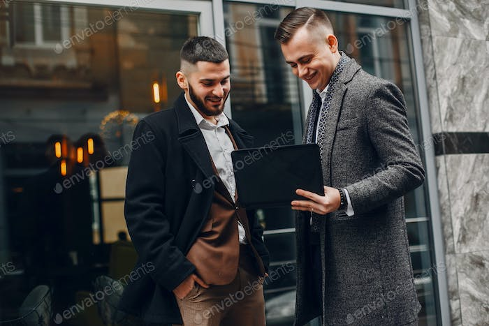 Two businessmen working with a laptop