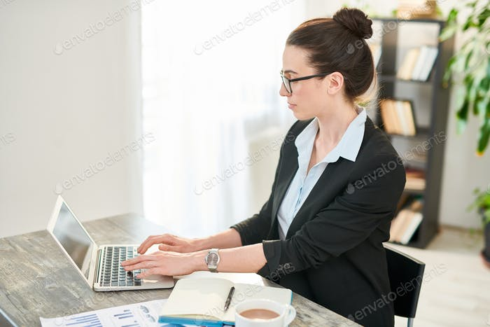 Confident Businesswoman at Workplace
