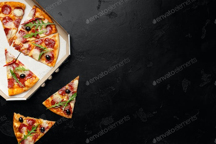 Pepperoni Pizza Slices On Black Background, Top View