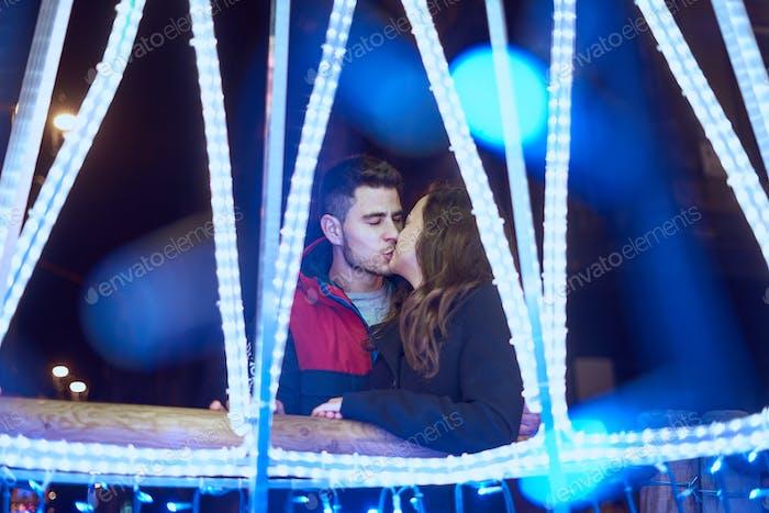Young couple enjoying Christmas Lights