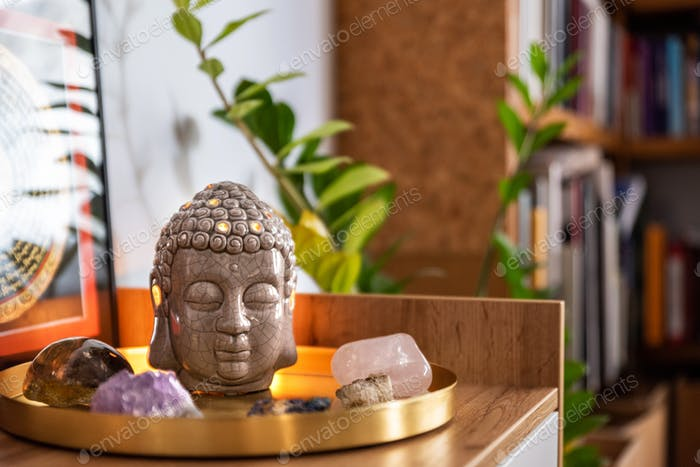 Buddha head with crystals. Balance and calm energy flow in home.