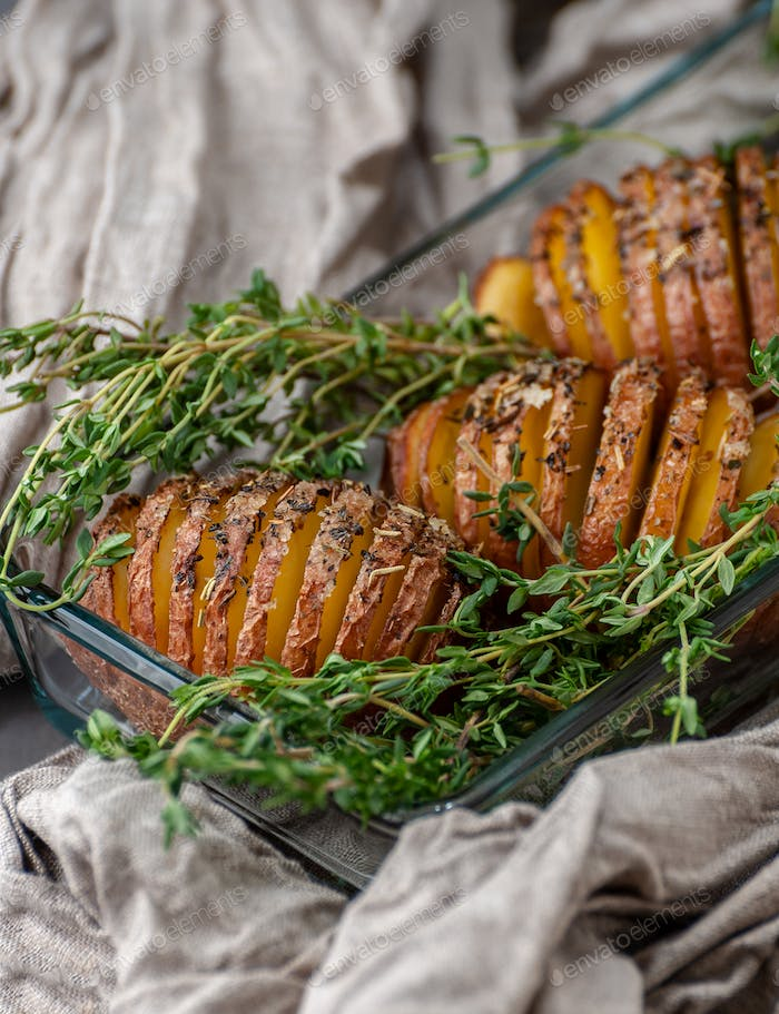 Baked potatoes in glassware in a rustic style. Food photography