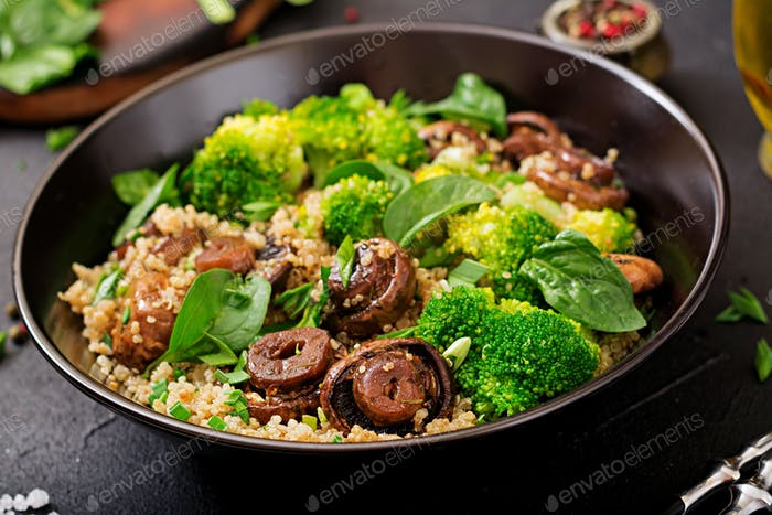 Dietary menu. Healthy vegan salad of vegetables - broccoli, mushrooms, spinach and quinoa in a bowl