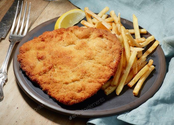 Weiner Schnitzel with fried Potatoes