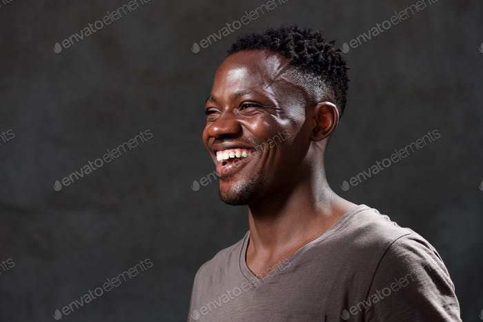 Thumbnail for young african american man laughing and looking away