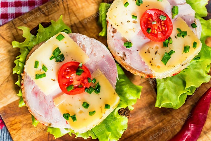 Sandwiches with cheese, turkey, lettuce and tomato