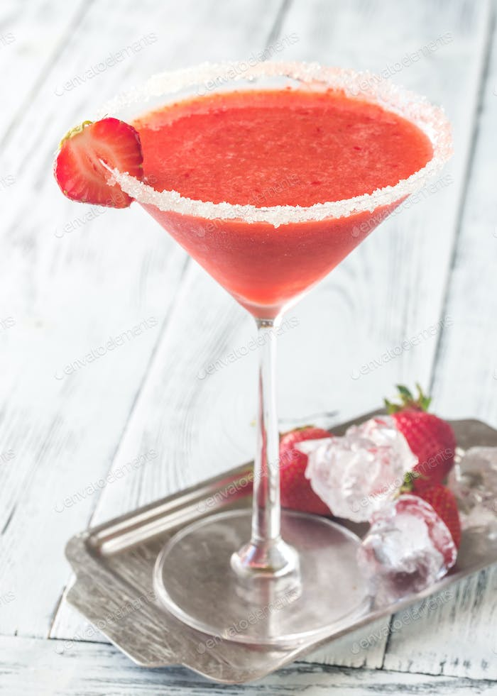 Glass of strawberry margarita cocktail