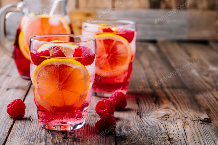 Sparkling Lemon Raspberry Lemonade Sangria in glass on wooden background