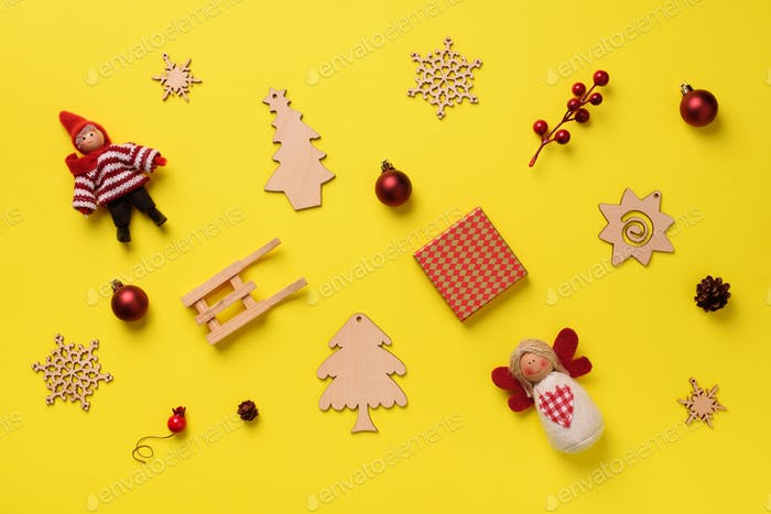 Greeting card for New year party. Christmas gifts, decorative elements and ornaments on yellow