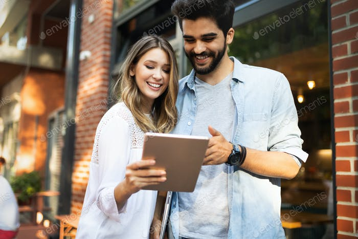 Portrait of a cheerful couple shopping online with laptop