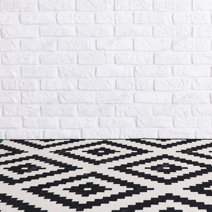 Empty room with brick wall and patterned floor