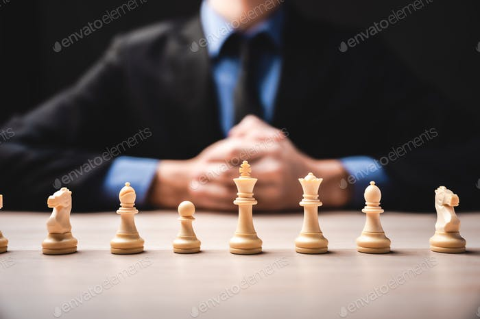 idea of winner, business leadership and successful concept with chess pieces and businessman hand