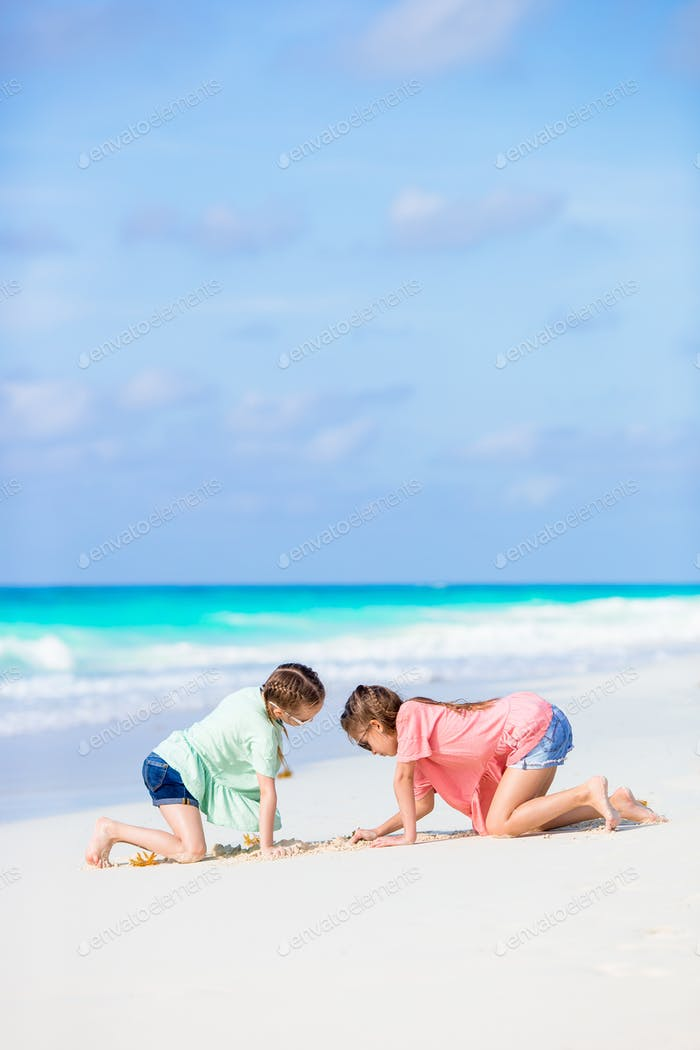 Adorable little girls during summer tropical vacation