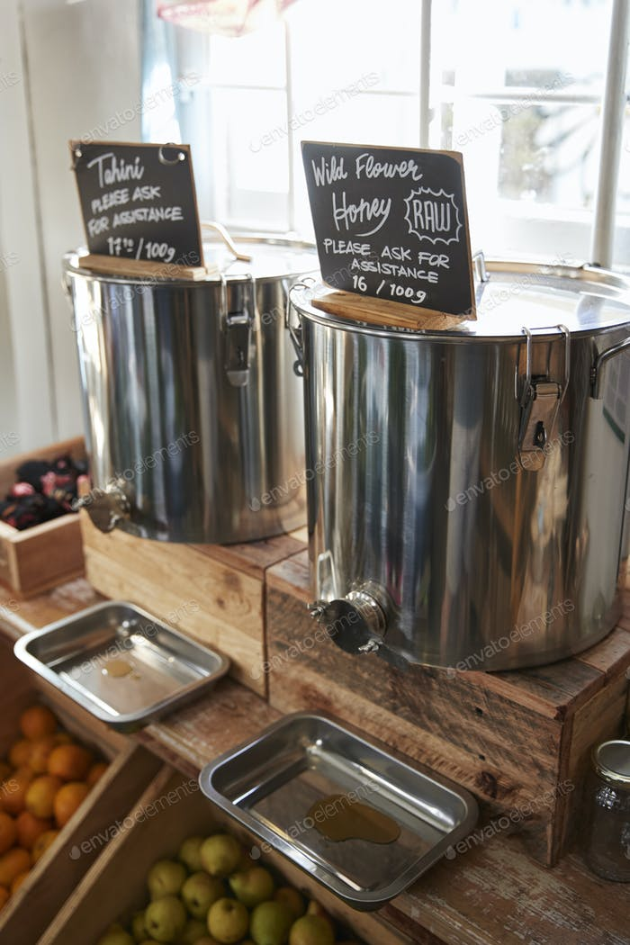 Dispensers For Honey And Tahini In Sustainable Plastic Free Grocery Store