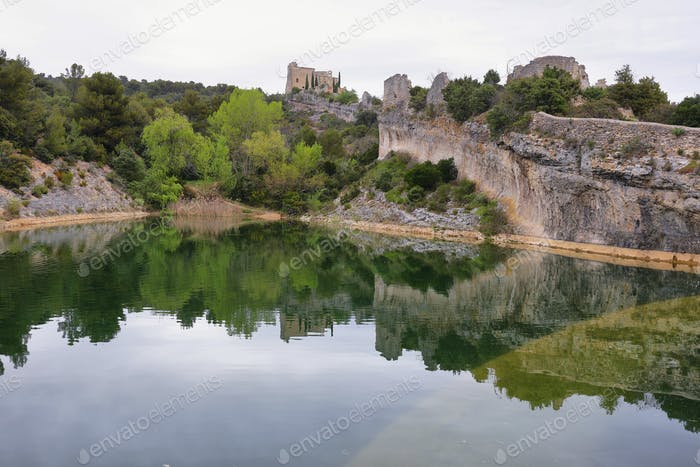 View of castle ruins and lagoon in St Saturnin les Apt, France