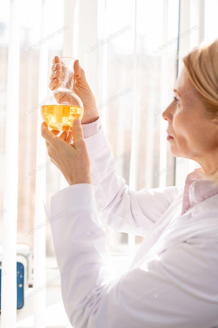 Woman examining chemical reaction