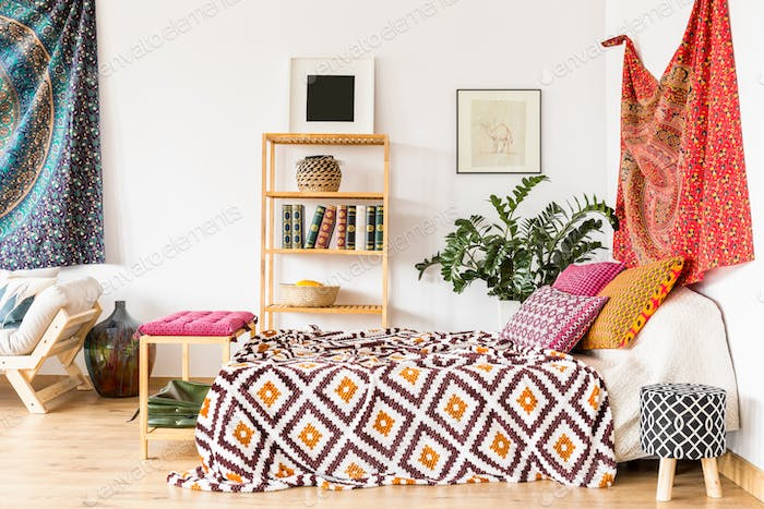 Bed in ethnic bedroom